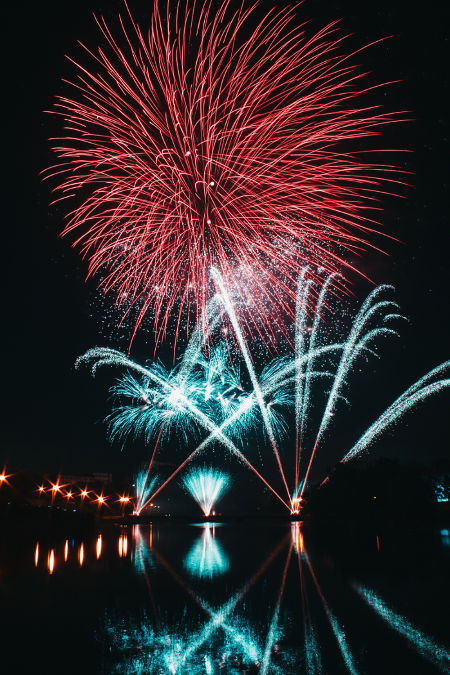 Red and blue fireworks in Sardinia for corporate events